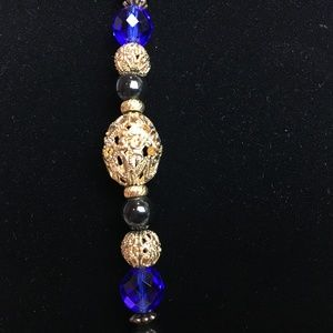 1928 Necklace with Black, Blue, & Gold Metal beads